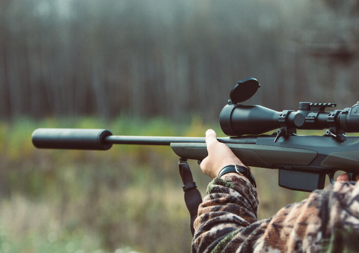 Hunter shooting rifle